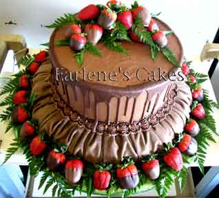 Rolled Chocolate Fondant Icing With Dipped Strawberries And Grapes Pierce Grooms Cake